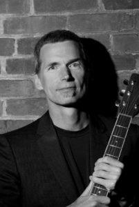 Photo of Neil Bjorklund with guitar